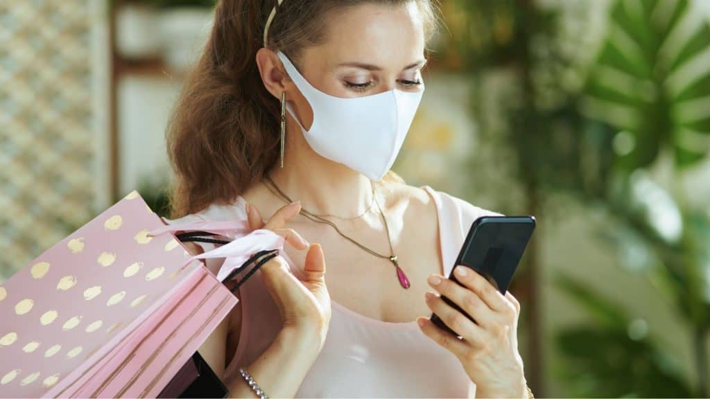 Woman shops through mobile device
